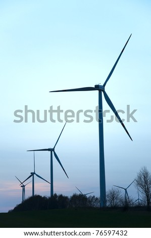 Wind farm at colorfull sunset