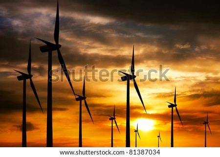 Wind farm at sunset - stock photo