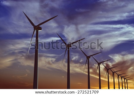 Wind farm at sunset - 3D rendered illustration - stock photo