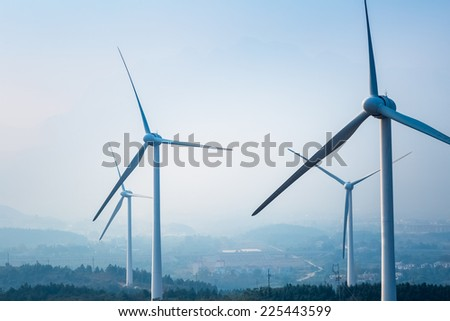 wind farm closeup ,new energy with fog and haze weather   - stock photo
