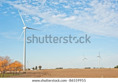 Wind farm in Paulding County, Ohio.  More than 50 wind turbines decorate the corn fields and rural landscape in northwest Ohio. - stock photo