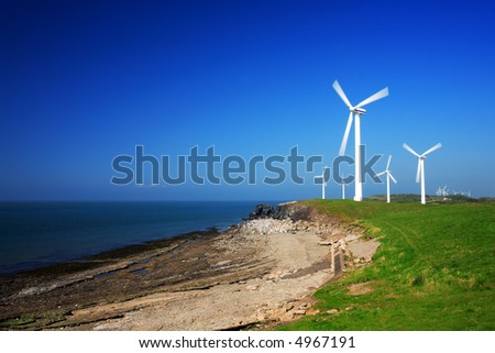 Wind farm on coast. More in my portfolio. - stock photo