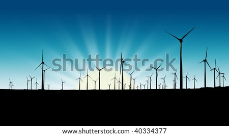 Wind farm silhouette at sunset - stock photo