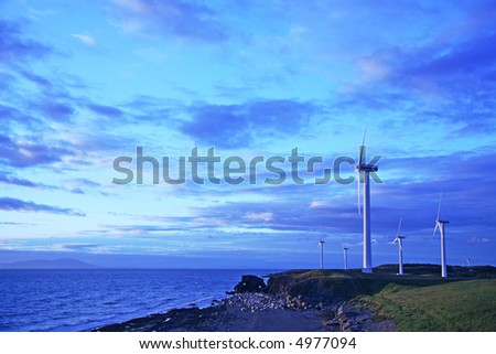 Wind farm with dramatic dusk sky with plenty of copy space. More power images in my portfolio. - stock photo