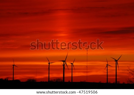 wind farm with dramatic sunset