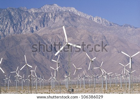 Wind farm with hills in background, Palm Springs, California - stock photo