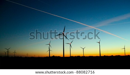 wind generator at sunset - stock photo