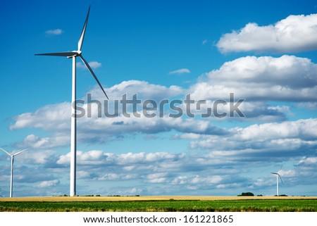 Wind generator turbines on summer landscape - stock photo