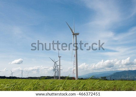 Wind Generator Turbines over Blue Sky