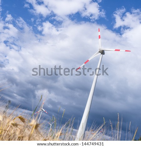 wind generators and a wheat field