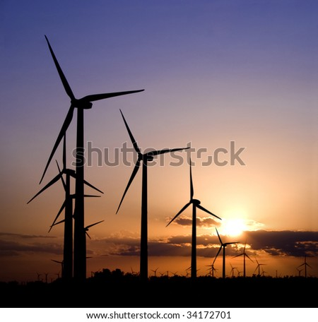 Wind generators at sunset - stock photo