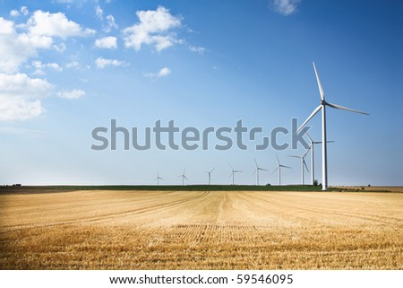 Wind generators in a row - stock photo