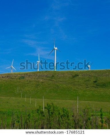 Wind generators of electric energy on a green hill