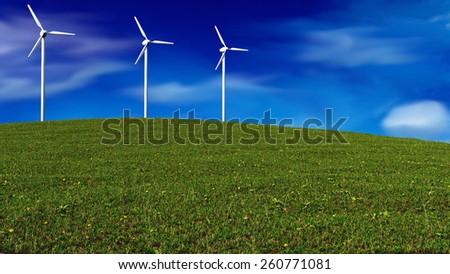 wind generators on grass meadow - renewable energy concept - stock photo