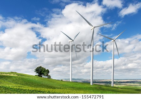 Wind generators turbines on summer landscape - stock photo