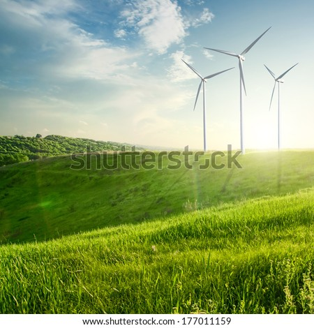 Wind generators turbines on sunset summer landscape - stock photo