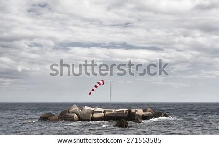 Wind indicator in mediterranean coastline. Alicante, Spain. Horizontal - stock photo