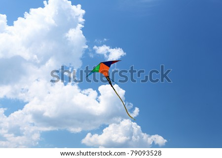 wind kite flying in the blue summer sky - stock photo