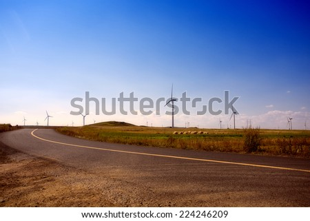 Wind mill far land along the road,north china - stock photo
