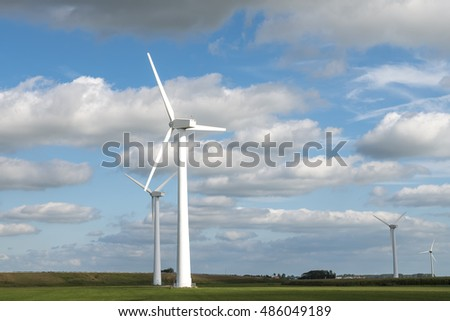 Wind mill in landsape against sky with clouds for energy power production electricity