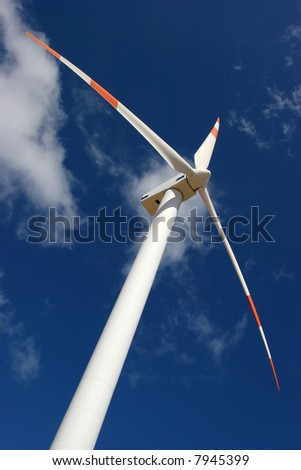 wind mill power generator in a deep blue sky