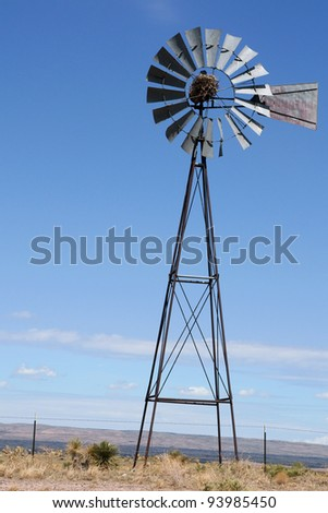 Wind mill pump in USA - stock photo