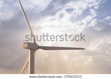 Wind mill rotor close up against nice sunny sky