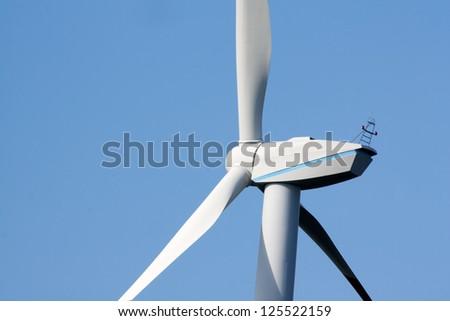 Wind mill - the motor head part again sunny sky - stock photo