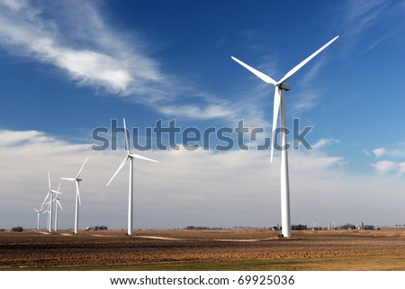 wind mill turbine in a farmland for green energy - stock photo