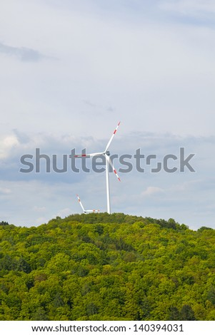 wind mills producing energy in the Saarland - stock photo