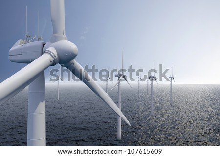 Wind park on ocean with blue sky - stock photo