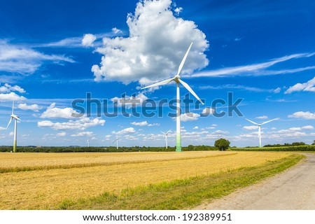 wind park technology Pinwheels on a agriculture cornfield background - stock photo