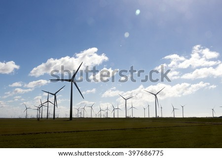 wind park with cloudy sky