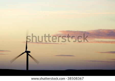 Wind power aerogenerator skyline at dusk