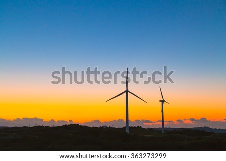 Wind power generation and sunset  - stock photo