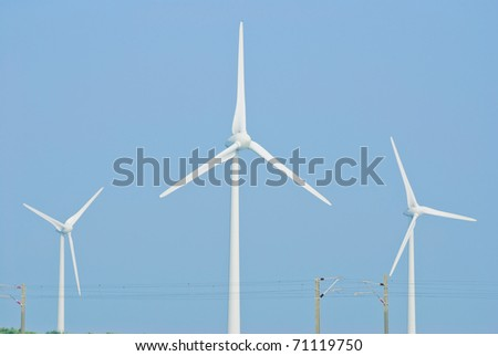 Wind power generation machine under blue sky