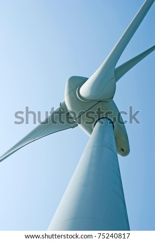 Wind power generation machine under blue sky - stock photo
