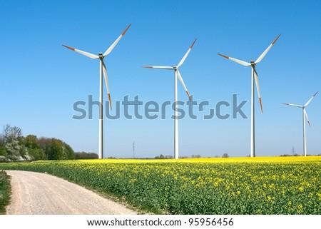 Wind power generators in the field - stock photo