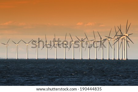 Wind power generators on sea - stock photo