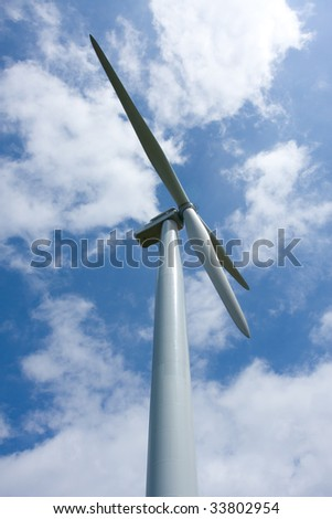 Wind power installation in sunny day - stock photo