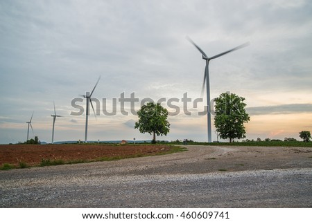 Wind power installations in agriculture the country at thailand. - stock photo