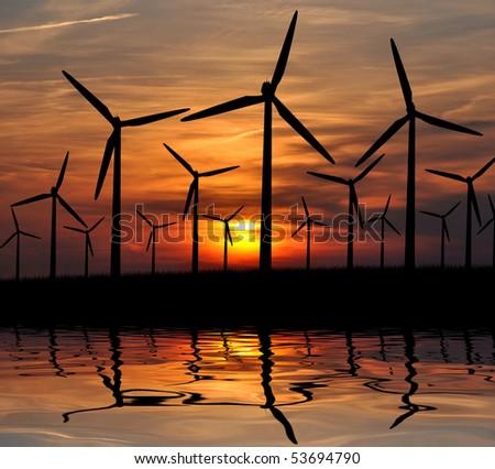 Wind power landscape at sunset - stock photo