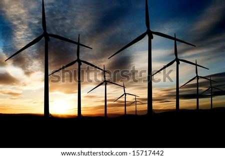 Wind power landscape at sunset on a flat horizon