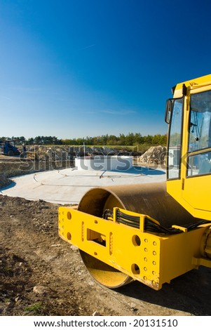 Wind power plant construction and yellow roller - stock photo