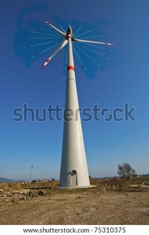 wind power plant under construction - stock photo