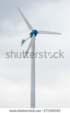 Wind power station against and light sunset, Power generation wind turbines - stock photo