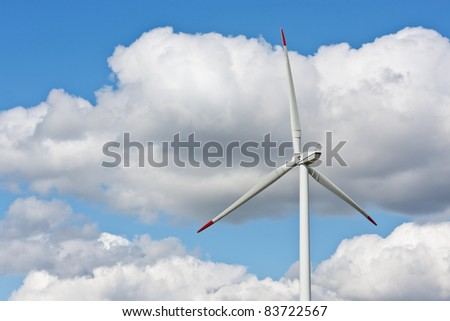 Wind power station against the blue sky with clouds - stock photo