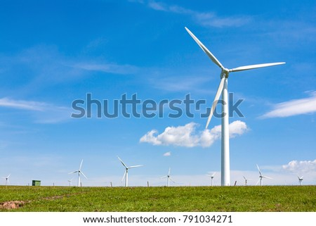 wind power station in the country in blue cloud sky