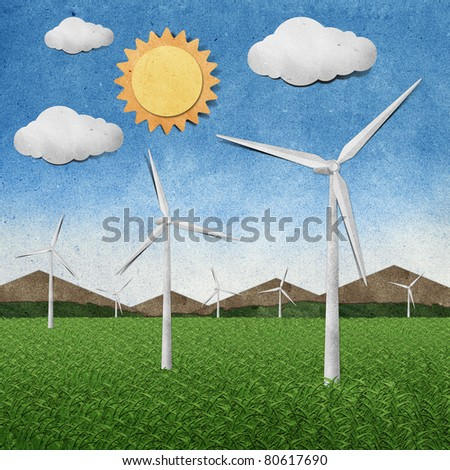 Wind power station recycled paper craft stick on paper background - stock photo