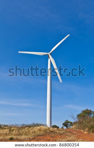 Wind power station - wind turbine against the blue sky,Thailand - stock photo